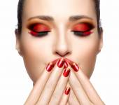 Beautiful Girl in Red with Hands on Her Face. Nail Art and Makeu — Stock Photo