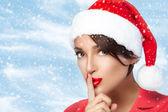 Christmas Girl in Santa Hat doing a Hush Sign. Fashion Christmas — Stock Photo