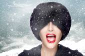 Winter Fashion Girl Gesturing with Fur Hat Covering Her Eyes — Stock Photo