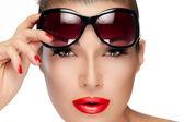 Beautiful Model Holding Fashion Sunglasses on Forehead — Stock Photo