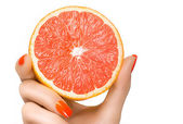 Female Hand Holding a Luscious Healthy Grapefruit. Isolated — Stock Photo