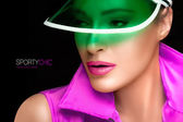 Gorgeous Woman in Green Sun Visor and Colorful Sportswear — Stock Photo