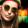 Beautiful Party Girl Enjoying Music Through Headphone — Stock Photo #72952009