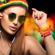 Beautiful Party Girl Enjoying Music Through Headphone — Stock Photo #73122459