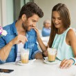 Beautiful couple in cafe enjoying the time spending with each ot — Stock Photo #54063481