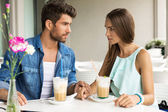 Two young people drinking frappe in restaurant — Stock Photo