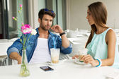 Attractive couple in restaurant drinking frappe — Stock Photo