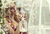 Blonde woman with baubles — Foto de Stock