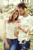 Beautiful couple walking in the garden — Stock Photo