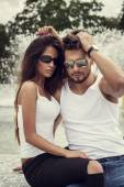 Attractive couple in sunglasses — Stock Photo