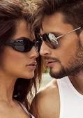 Sexy couple in sunglasses — Stock Photo