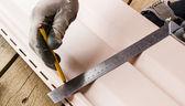 Builder doing metering corner straightedge — Stock Photo