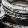 Close-up details of an old silver metallic lens camera — Stock Photo #79488840
