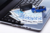 Toy car and banknotes — Stock Photo