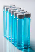 Bottles with blue liquid — Stock Photo