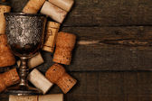 Medieval goblet and wine corks — Stock Photo