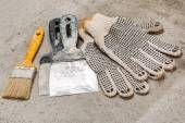 Spatulas, brush and gloves — Stock Photo