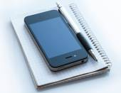 Smart phone and notepad — Stock Photo