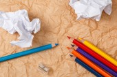 Pencils and crumpled paper — Stock Photo