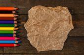 Multicolored pencils and crumpled paper — Stock fotografie