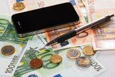 Smart phone and money — Stock Photo
