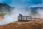 Tourists in geothermal area — Stock Photo