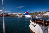 Icelandic flag flying from a boat — Stock Photo