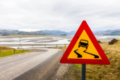 Warning traffic sign for wet roads — Stock Photo