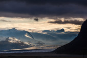 Sunset over snowy mountains — Stock Photo