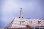 Spire and dormer windows — Stock Photo