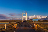 Road leading over a suspension bridge — Stockfoto