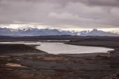 Lake in a barren volcanic landscape — Stock Photo
