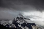 High snow-capped mountain peak — Stock Photo
