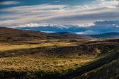 Distant farmhouse in a remote landscape — Stock Photo