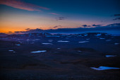Sunset over a mountainous landscape — Stock fotografie