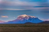 High snow-capped volcanic peak — Stock Photo