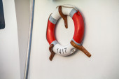 Life preserver mounted on a wall — Stok fotoğraf