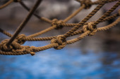 Rope net in the rigging of a boat — Stock Photo