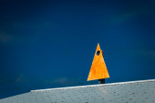 Yellow triangle mounted — Stok fotoğraf