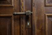 Interesting antique metal door handle — Stock Photo