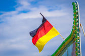 German flag on a green roof — Stock Photo