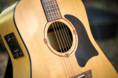 Acoustic guitar out of light wood  — Stockfoto