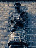Man made of red bricks — Stock Photo