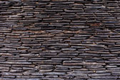 Close up of a brick-wall, Modern black stone texture background. — Stock Photo