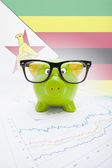 Piggy bank with flag on background - Zimbabwe — Stock Photo
