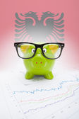 Piggy bank with flag on background - Albania — Stock Photo