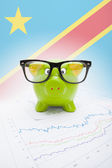 Piggy bank with flag on background - Democratic Republic of the Congo — Stock Photo
