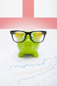 Piggy bank with flag on background - England — Stock Photo