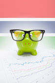 Piggy bank with flag on background - Gambia — Stock Photo