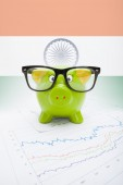 Piggy bank with flag on background - India — Stock Photo